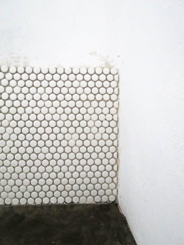 DIY backsplash using penny tiles