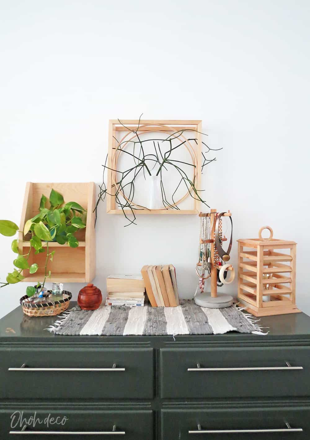 An easy DIY to build a geometric display shelf using embroidery loops and wood trim. #diyshelf #storage #displayshelf #wallshelf #homedecor #diy