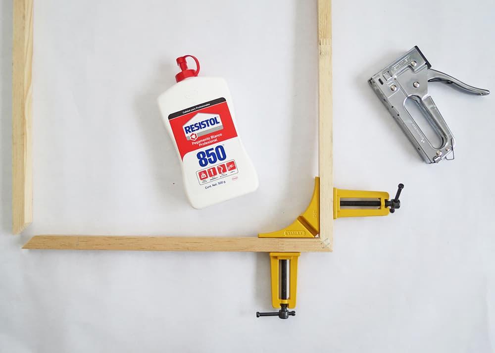 An easy DIY to build a geometric display shelf using embroidery loops and wood trim. #diyshelf #storage #displayshelf #wallshelf #homedecor #diy
