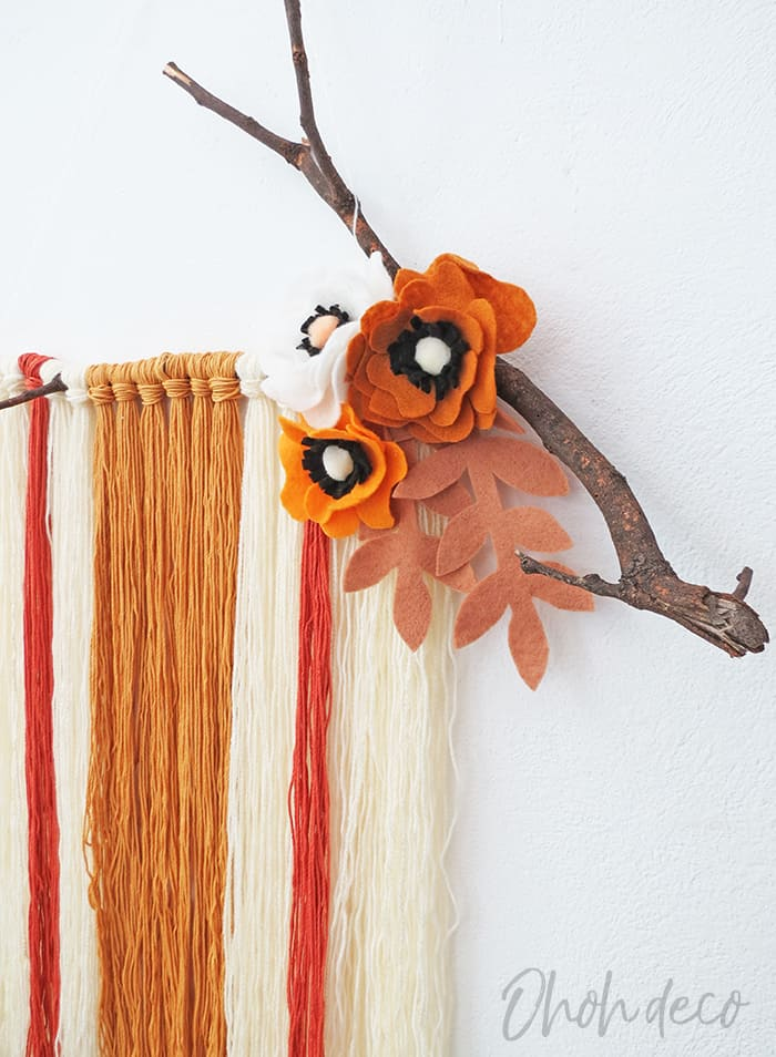 DIY yarn wall hanging with felt flowers