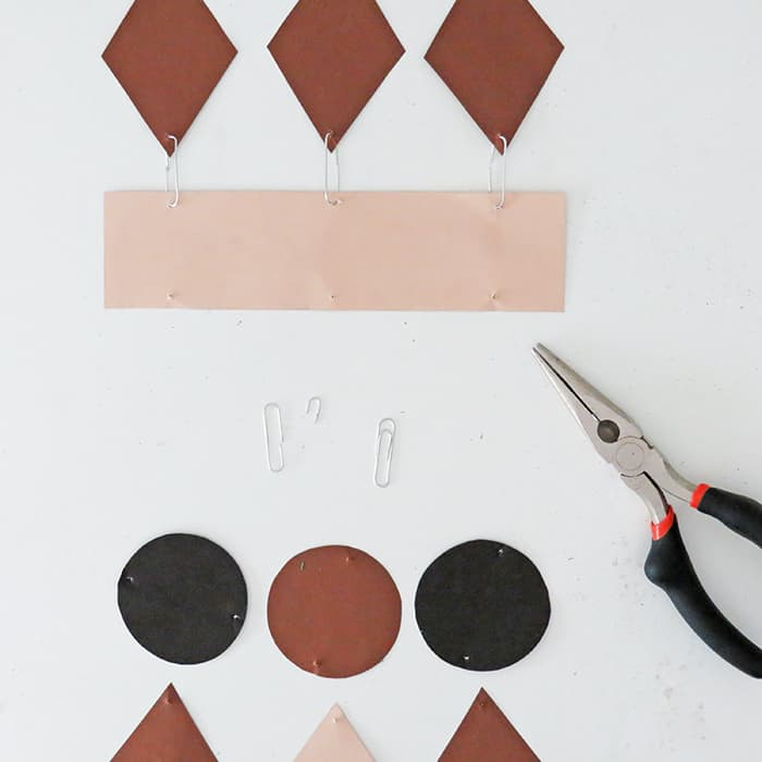 attach shapes to make paper wall hanging