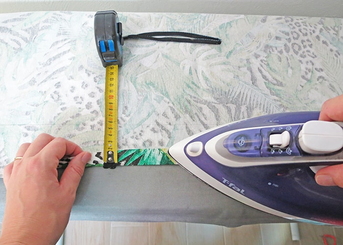 fold the fabric edge to make relaxed roman shades