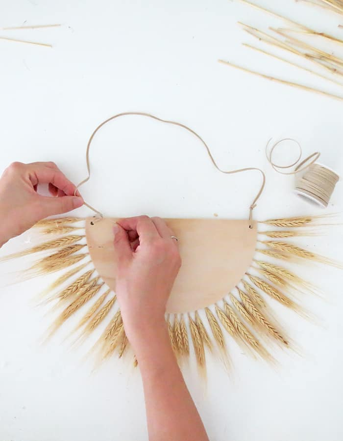 pass twine to hang the wheat wall decor