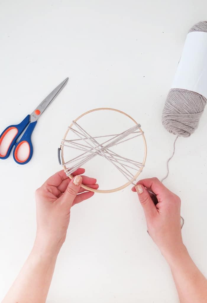 wrap yarn to make a large pom pom