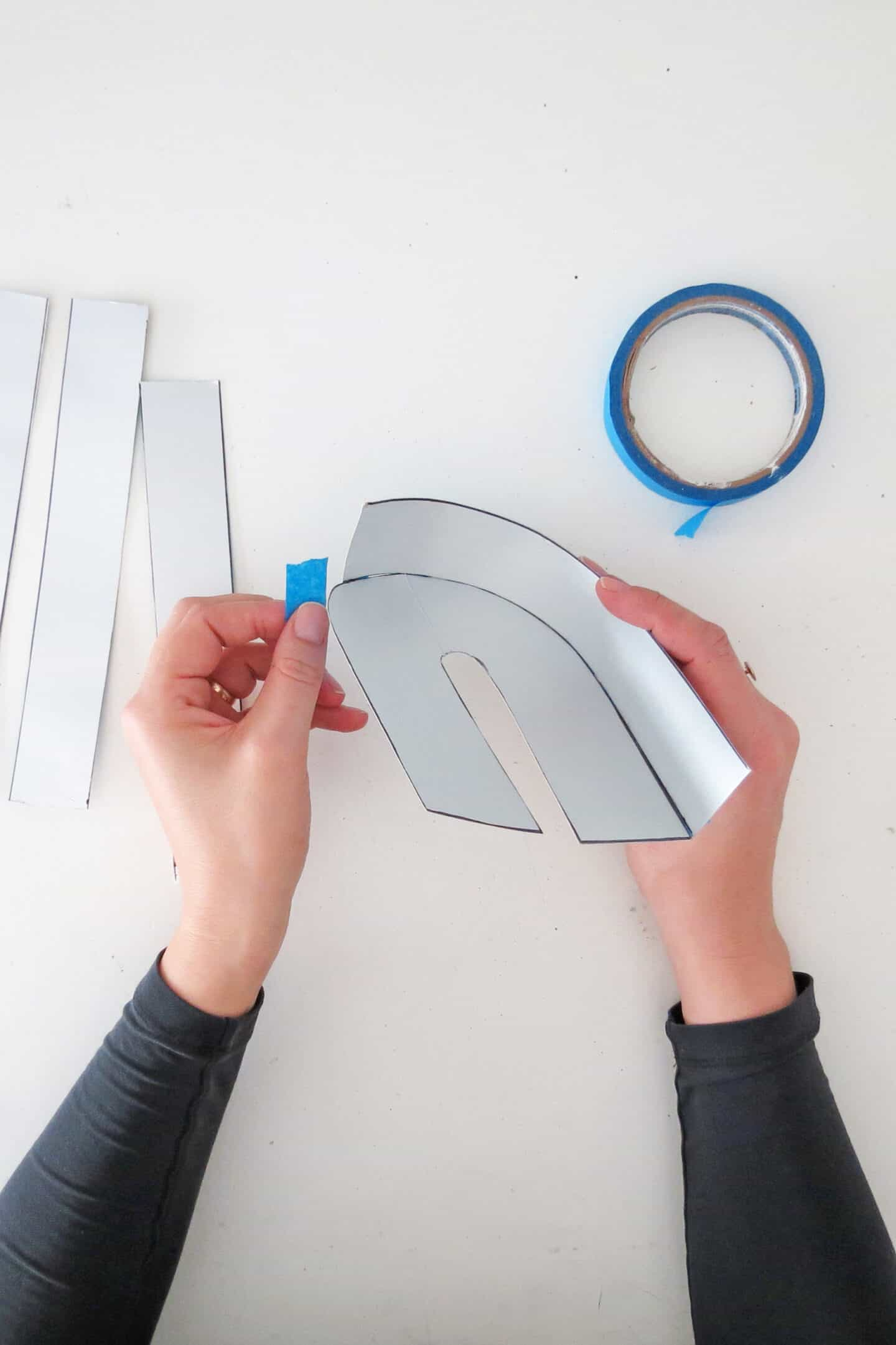 assemble the cardboard to make diy phone stand