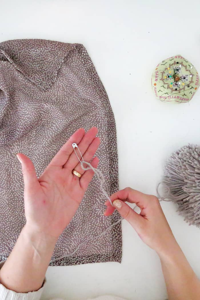 how to attach a pom pom to a scarf