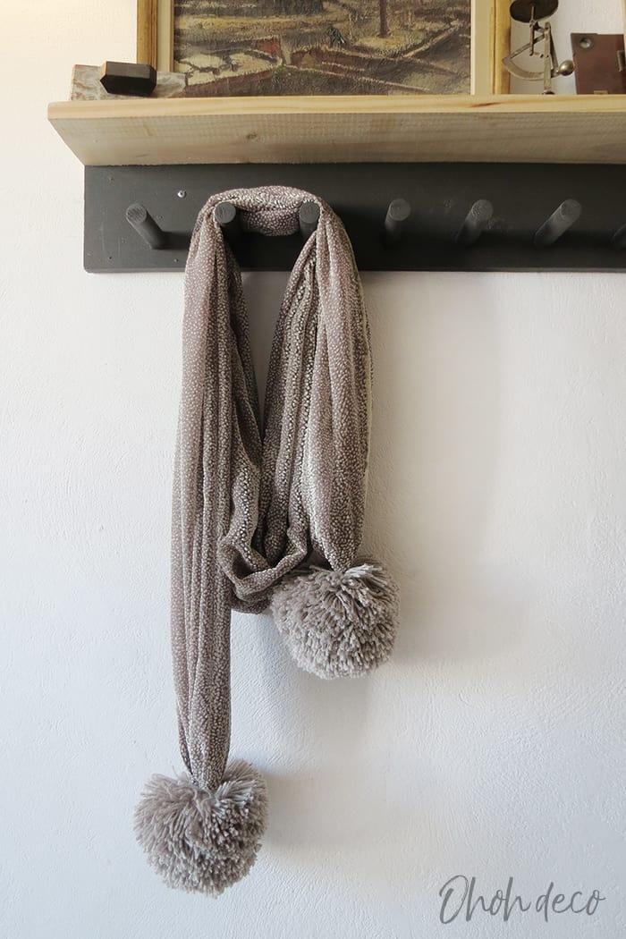 Adding pom poms to scarf