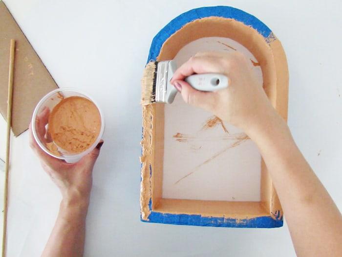 apply paint on add cardboard layers to diy wall shelf