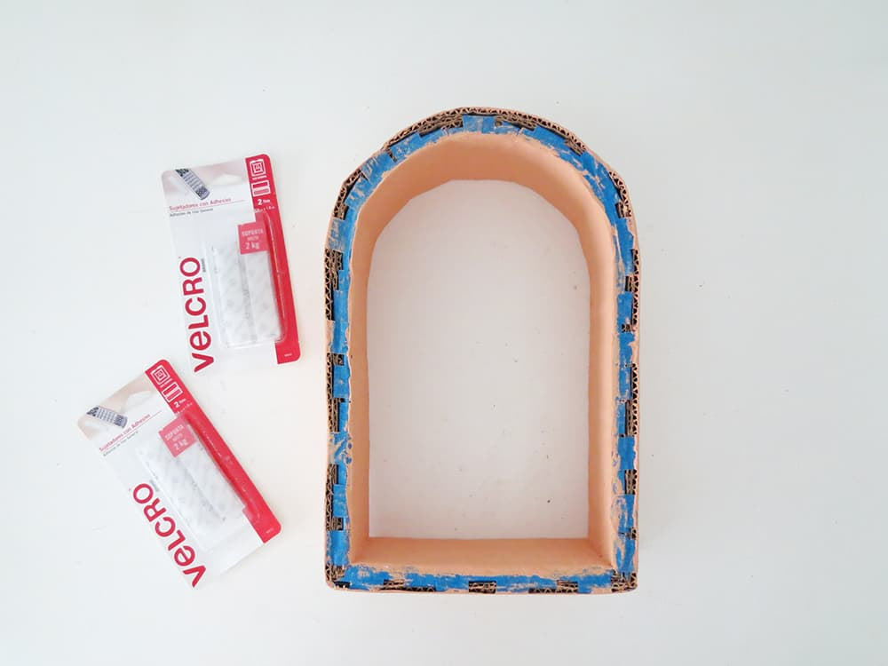 add velcro on the back to hang the wall shelf