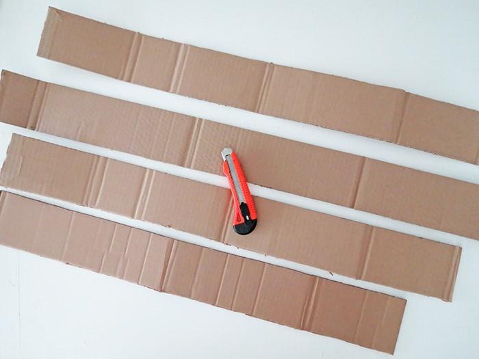 Cut cardboard to make diy wall shelf