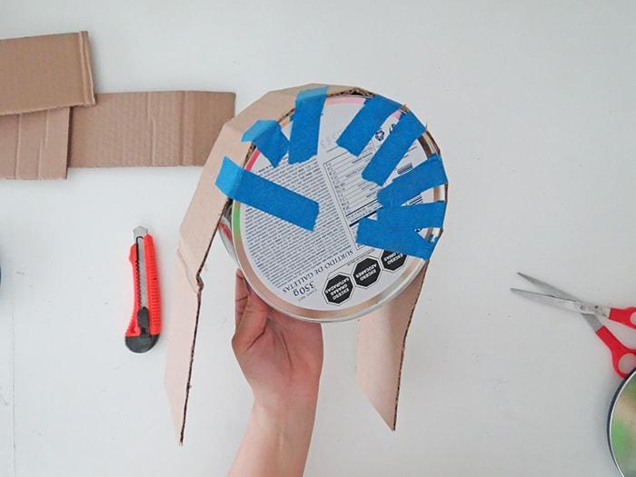 tape cardboard to diy wall shelf