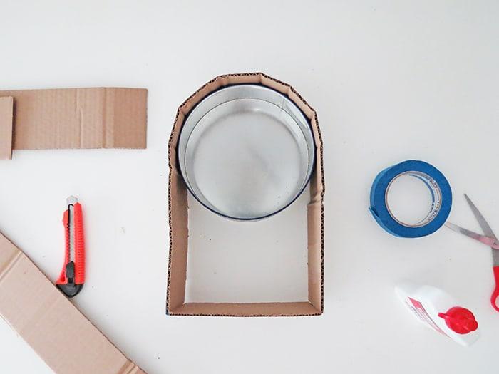 tape the base to make DIY cardboard shelf