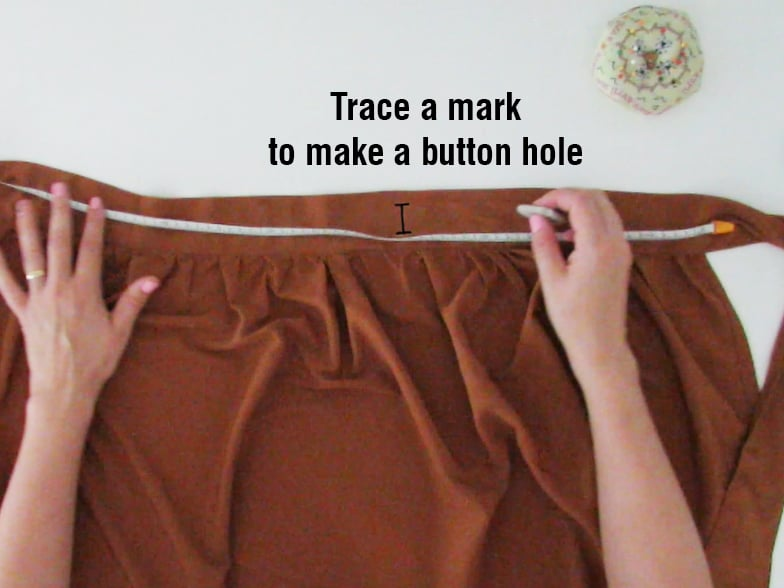 make a button hole to close the skirt
