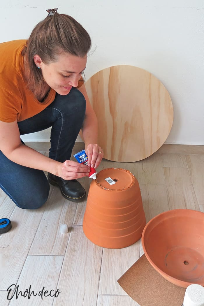 glue the planters to make the coffee table base