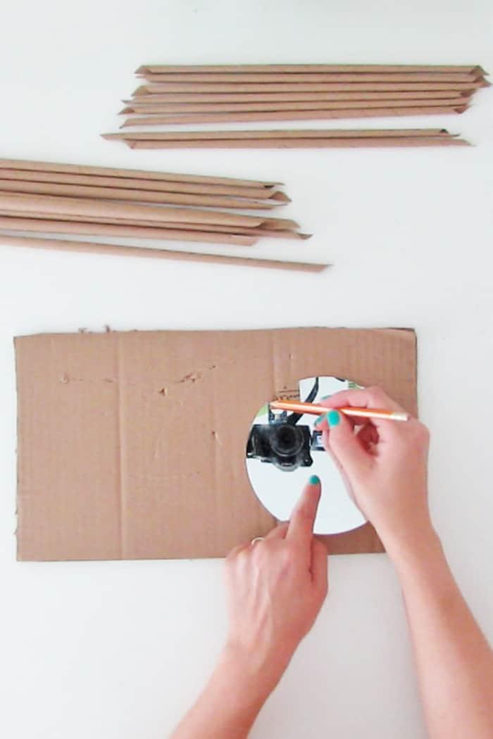 cut the cardboard to make the wall mirror