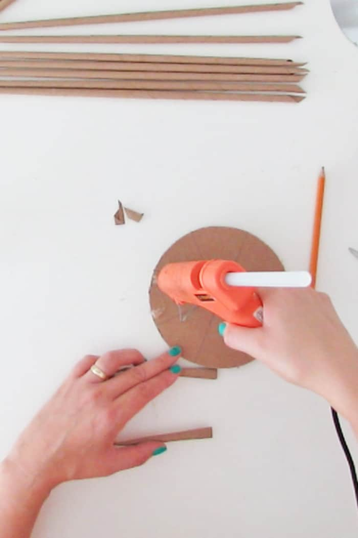 glue to paper on the cardboard