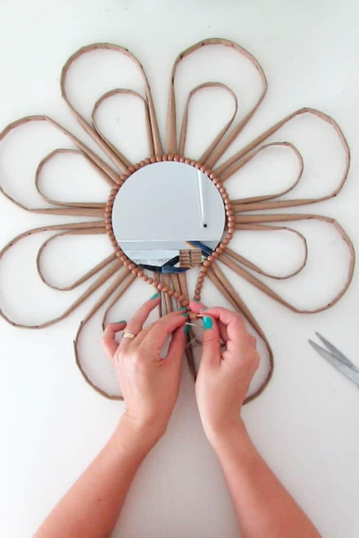 add wooden beads around the mirror
